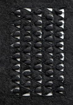 Contemporary Textiles Design with embroidered triangle pattern & cutout detail; fabric manipulation // Aimee Betts