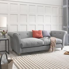 """CHESTER. We've updated the traditional Chesterfield sofa with fewer buttons and cleaner lines and then we've added our own lovely weathered oak legs. """"Champion!"""" as our Derbyshire sofa-makers say."""