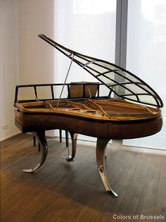 Elegant piano in Maison Particulière's Art Center petit salon in Brussels from the blog, Colors of Brussels