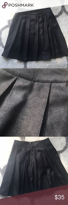 Saks fifth avenue red label pleated skirt Gorgeous black and not overwhelmingly shimmery pleated skirt from Saks Red label line. Looks gorgeous for a night out or dressed down. Just a little small on me now but versatile and beautiful. 97% polyester 3% spandex. Only worn once or twice in great condition Saks Fifth Avenue Skirts Circle & Skater