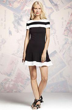 Embrace your inner '60s bombshell in this mod black-and-white dress. Colorblock Flounce-Hem Dress; Peter Som for DesigNation.