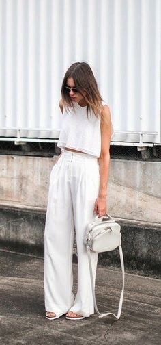 Balance a pair of wide leg trousers with a crop top.   Via hernewtribe.com