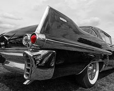 Tailfins and tail lights on a classic American car - black 1957 Cadillac Coupe De Ville. #taillights #fifties