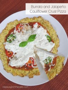 This cauliflower crust pizza is loaded with creamy burrata and spicy jalapeños! A vegetarian recipe that is gluten free and keto friendly!