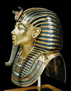 Tutankhamun's funeral mask in solid gold inlaid with semi-precious stones and…