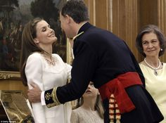 A royal kiss: Queen Letizia gazes lovingly at her husband Felipe VI moments after he officially became king in a ceremony at the Zarzuela Palace in Madrid