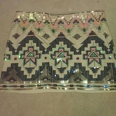 Express Aztec Print Skirt!!! Express Aztec Print sequin skirt. Love this skirt..... Only worn one time. Perfect condition!!!! Cream colored with the variety of sequins (blue, green, iridescent pink, and silver) nude layer underneath as well Express Skirts Mini