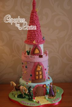 Tangled princess tower birthday cake - My daughters were Tangled mad last year so I made them this.....its not quite the tower in the film but a tower fit for a princess none the less.....