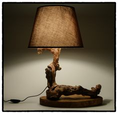 Luxurious driftwood lamp shaped almost as Chinese Dragon. Body is rich in details and texture. To bring to surface it's natural structure, we did not use any heavy machines. Just a simple saw, drill and the sandpaper...and the most important thing ... love and patience.   The surface has beautiful coloring and endless patterns.    It is not only beautiful to look at its' patterns and curves, but also to touch it and to enjoy warm and soft feeling that only natural wood can bring.
