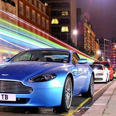 Cool Aston Martin leading the pack! cool photo!