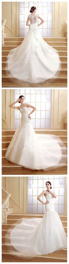 Make a wow entrance in this gown! The train, back and detailed flowers is just gorgeous! Would you wear it?