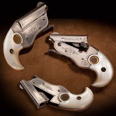 """Hopkins & Allen Vest Pocket Pistol- Collectors have called the GOTD by several designations: H&A New Model Vest Pocket Derringer, Hopkins & Allen Parrot Beak Derringer, H&A """"Bird Beak Special"""" & others. This rare .22 single-shot was made only from 1911-15. This example has factory gilt round medallion mother-of-pearl grip panels and scroll engraving. It is one of the smallest pistols for conventional ammunition ever made. NRA National Firearms Museum in Fairfax, VA."""