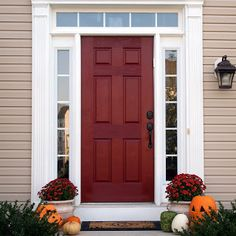 coordinate front door color with potted flowers