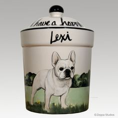 A custom hand painted pet portrait of a French Bulldog on a ceramic canister.