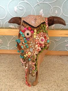 Beaded Cow Head Western Home Decor - creepy and still somehow fun!  Do you know how many deer heads we have out here??