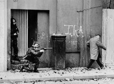 British Army soldiers patrol the Bogside quarter of the city of Londonderry during heavy clashes between Catholics and Protestants. November 4th, 1971