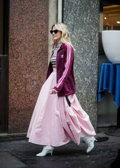 Helena Bordon wearing pink skirt Adidas jacket seen outside Sportmax during Milan Fashion Week Fall/Winter 2018/19 on February 23 2018 in Milan Italy