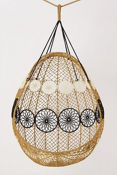 """Knotted Melati Hanging Chair  Online Exclusive   style # 960073  Sling this pod of citrus or neutral-hued macrame from porch rafters or tree branches and take in the gentle summer breezes.   Hanging hardware required   Polyester   48""""H, 37""""W, 30""""D   Imported   $498"""