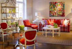 Color, curves, acrylic and coral – oh my! This living room just makes us happy, with its colorful fabrics and natural and acrylic accents.