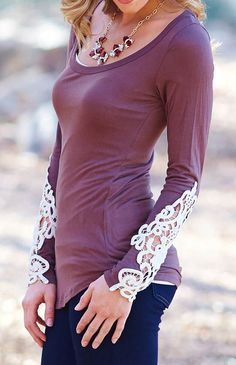 This is the style i look for. When a simple cotton shirt has a splash of unexpected. Rather it's an uneven hem line or the lace on this shirt. Cristie