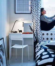 A black and white polka dot bedroom scheme, plus a white desk, chair and painted floor, with a woman sitting in the window. Polka Dot Bedroom, Brimnes Bed, Catalogue Ikea, Monochrome Bedroom, Flexible Furniture, High Beds, Bed Frame With Storage, White Desks, Ideas Geniales