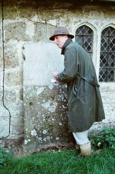 Tom Baker with his gravestone.