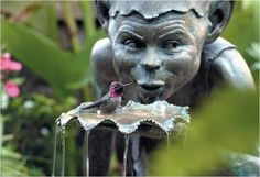 I'd love this fountain/sculpture in my garden.   Cottingley Fairies by David Goode.