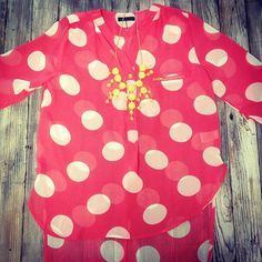 We love this coral polka dot top!! $36.95!