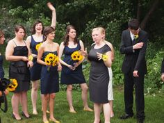 navy/yellow wedding party all different navy dresses, yellow flowers, nude shoes
