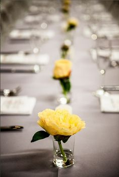 If you're a DIY bride with a budget, consider this minimalist idea - a single stem per small vase and the table centerpieces are done! Here, the bright yellow adds a pop of color. Shop roses and other popular wedding flowers at GrowersBox.com!