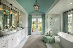 Spacious and luxurious, this gorgeous bathroom is a peaceful escape reserved for the masters of the house. Stunning tile work, soft fabrics and a calming color palette blend to form a decadent space designed for relaxation.