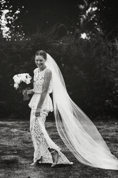 Love her hair and flowers and veil. Not crazy about the dress. Chloe Sippe.
