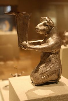 A Magnificent and Highly Important Proto-Elamite Silver Kneeling Bull Holding a Spouted Vessel, a Masterwork of the Proto-Elamite Period Sumerian. 3100-2900 BE Southwestern Iran.