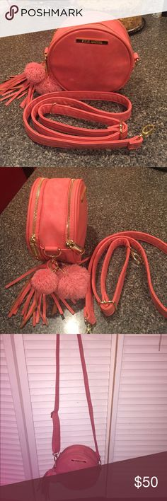 Steve Madden coral pink crossbody Two gold zippers for storage. ‼️FREE matching purse tassel and Pom Pom. ✨It has one mark from when I brought it. So minimal I decided to buy it anyway. Negotiable and serious inquiries‼️ Steve Madden Bags Crossbody Bags