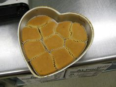 GENIUS! To create easy to decorate pull-apart cupcake cakes, place the liners into shaped pans. Then, pour the cupcake batter in and bake. The cupcakes will conform to the pan and create different shaped cupcakes that are still easy to separate.