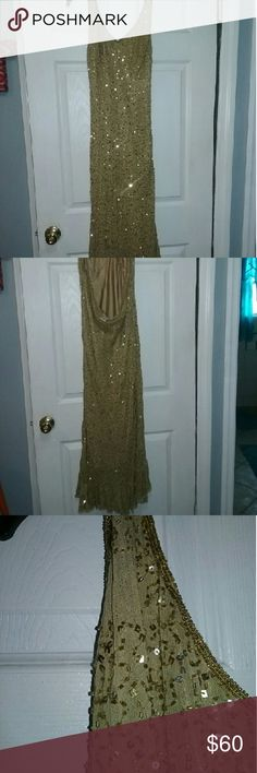Formal Gold Sequins dress size Size 16 Beautiful halter style formal Gold Sequins gown. Has a few wear issues such as some of the gold sequins have fallen off as is shown in pictures in three spots on dress.Can be replaced from craft store. Dress has only been worn once to a wedding. Halter style with a side zipper. Has a ruffled bottom. Very classy formal dress. Newport News Dresses Wedding