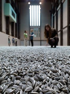 Visitors to the Tate Museum interact with Weiwei's intallation