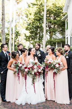 Blush bridesmaids' dresses paired with blush and raspberry wedding bouquets! | Angelita Esparar Photography