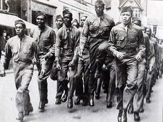 Black American GIs on Park Street Bristol, UK -  During WWII, a large number of American troops were stationed in or near Bristol. They included black soldiers, who were based in Muller's Orphanage on Ashley Down in Bristol. Bristol people were on the whole friendly towards the American soldiers, including the black soldiers. Many white American soldiers were horrified to see white women dancing with black men.