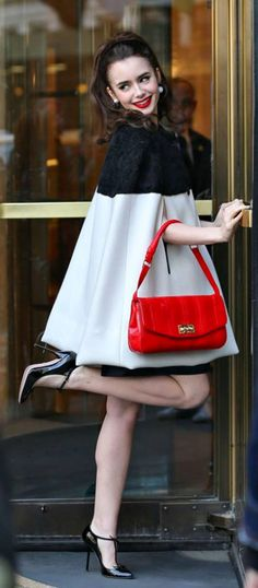 The kicking sixties: Lily Collins flicks up her leg as she poses for retro style…
