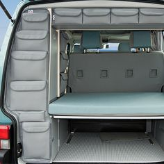 pockets on back of blanket cupboard, access from tailgate.