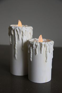 flameless candles made from PVC and hot glue. Bet you could use empty Pringles cans too.