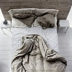Bed upside down. After sleep. Grey. Brown. Wood. Textile. White. Wake up. Bedroom. Empty bed. - Inspiration