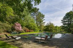 A tranquil, private pool area is nestled organically inside of a glorious wooded landscape.