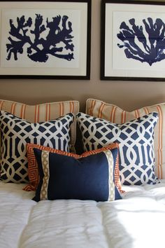 Nautical inspired prints with navy and orange pillows. I love the mix of patterns on the pillows.