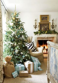 A mantel of pears, limes and lemons and vintage glass ornaments on the tree | Lisa Luby Ryan