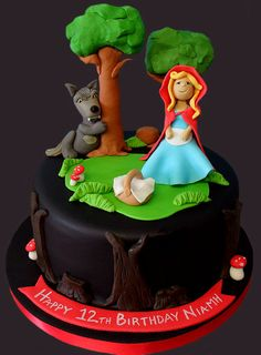 What big teeth you have grandma.The better to eat this cake with my dear!This cake shows Little Red Riding Hood walking throughthe dark forest with that Big Bad Wolf following closebehind.