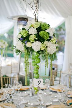 Lovely green wedding centerpiece with green apples. | Five ways to incorporate fruit wedding decor into your big day via @weddingpartyapp