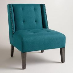 Accented with soft tufting and silver nailheads, our wingback chair is a comfortable classic covered in vibrant blue fabric for a pop of color.