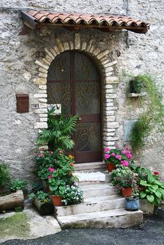 This entrance in Italy has everything - steps, colour, stonework, a tiled canopy - it just oozes character!